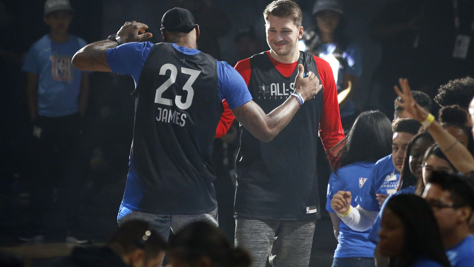 FILE - Lakers forward LeBron James (23) and Mavericks guard Luka Doncic (77) meet after player introductions during a practice for the 2020 NBA All-Star Game at Wintrust Arena in Chicago on Saturday, Feb. 15, 2020.