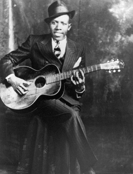 A 1935 photo shows blues guitarist and singer Robert Johnson, whose historic recordings in Dallas will be honored at downtown activities today.