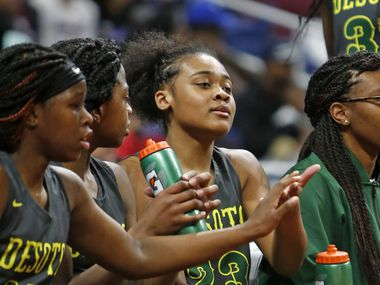 Desoto's Kendall Brown is congratulated as she came to the bench in closing minutes. UIL girls basketball Class 6A state semifinal between DeSoto and Humble Summer Creek. on Friday March 1, 2019 at the Alamodome in San Antonio, Texas.