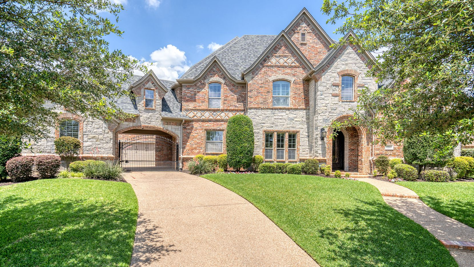 The five-bedroom home at 912 Chalet Court in Colleyville's Clairemont community has a saltwater pool, slide, outdoor kitchen and covered patio with a fireplace.