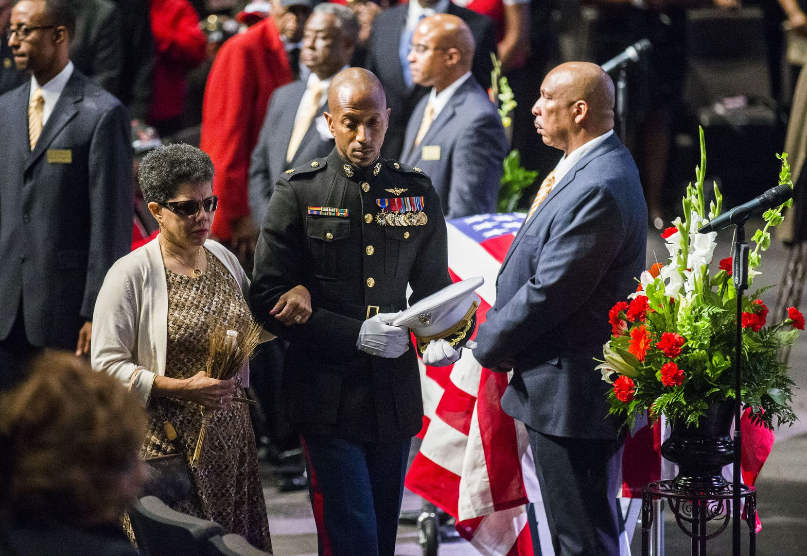 U.S. Marine Major Alejandro House, retired, escorts Gwenelle Johnson Spann during funeral services for her husband, retired Army Air Corps 1st Lieutenant Calvin Spann, on Saturday, September 12, 2015 at Covenant Church in Carrollton, Texas.  Spann was an original Tuskegee Airman and fighter pilot with the 100th Fighter Squadron of the 332nd Fighter Group.  He served during World War II, when he flew 26 combat missions. (Ashley Landis/The Dallas Morning News)