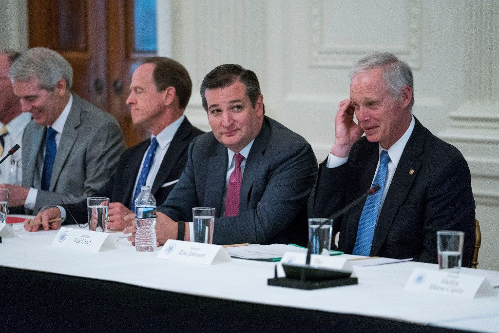 Sens. Ted Cruz (R-Texas) and Ron Johnson (R-Wis.) attended a round-table discussion that President Donald Trump convened with Senate Republicans to discuss health care legislation this week. (Doug Mills/The New York Times)