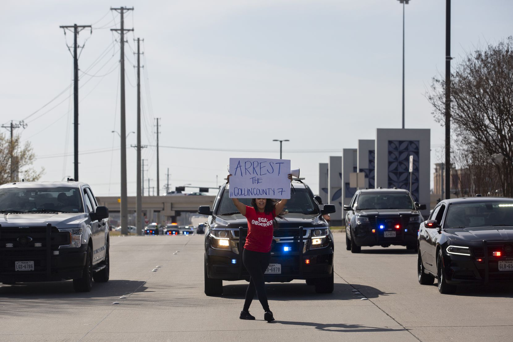 Renee White dances down the street as the tail end of the march leaving the Allen Outlets on Sunday, March 21, 2021. Demonstrators demanded justice for Marvin Scott III, who died a week prior while in custody at the Collin County Jail on March 14, 2021.  (Shelby Tauber/Special Contributor)