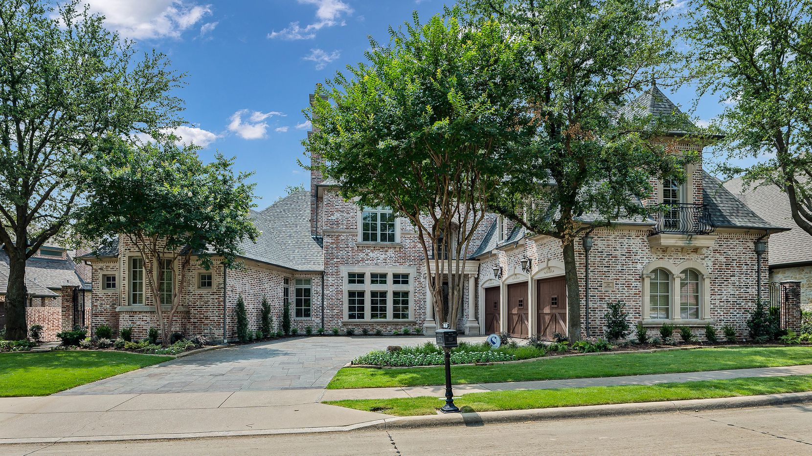 The Frisco home at 19 Armstrong Drive offers two downstairs master bedrooms and is priced at $2,449,000.