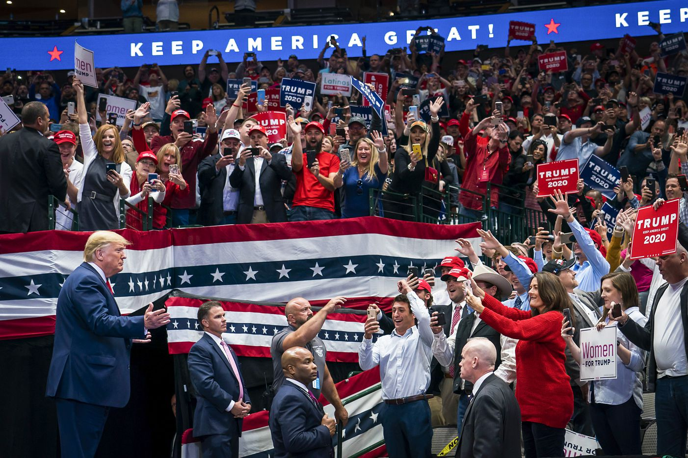 President Donald Trump acknowledges the crowd as he arrives for a campaign rally at the American Airlines Center on Thursday, Oct. 17, 2019, in Dallas.