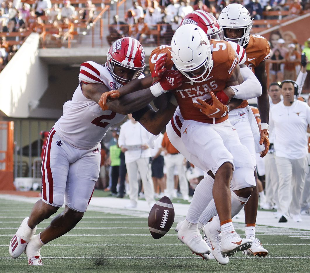 Louisiana-Lafayette Ragin Cajuns linebacker Lorenzo McCaskill (2) forces Texas Longhorns running back Bijan Robinson (5) to fumble the ball as he ran for the goal line during the third quarter at DKR-Texas Memorial Stadium in Austin, Saturday, September 4, 2021. Texas recovered the ball. (Tom Fox/The Dallas Morning News)