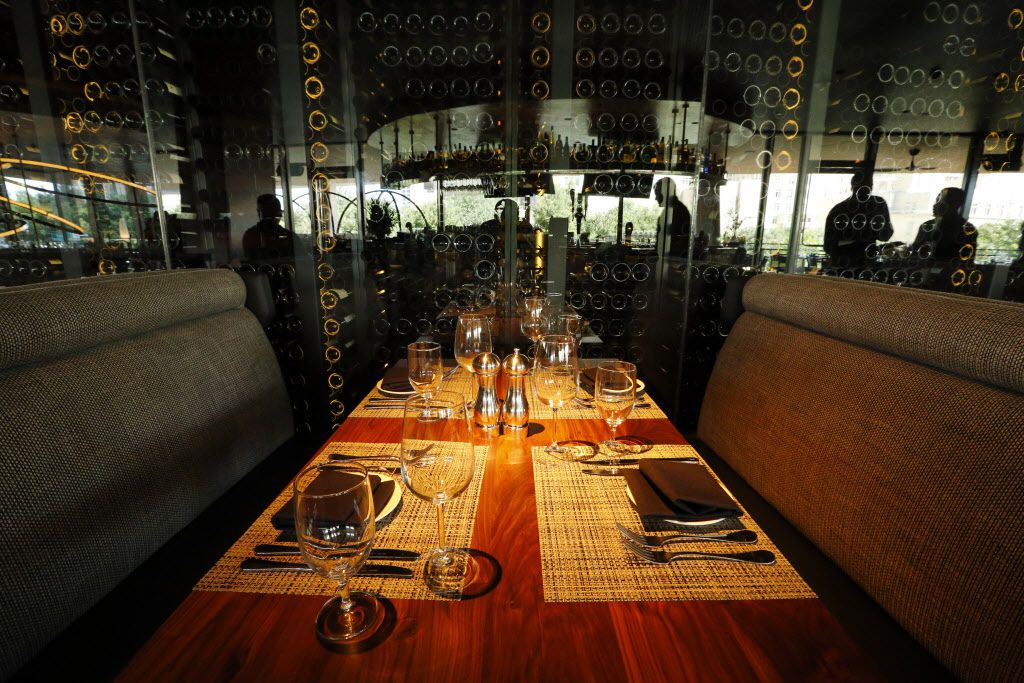 The upper dining area is reflected in the glass covered wall of wine bottles at the new Del Frisco's Double Eagle Steak House in Uptown Dallas, Friday, September 9, 2016. The original, located on Spring Valley since 1994, has closed and the new one opens Saturday. (Tom Fox/The Dallas Morning News)