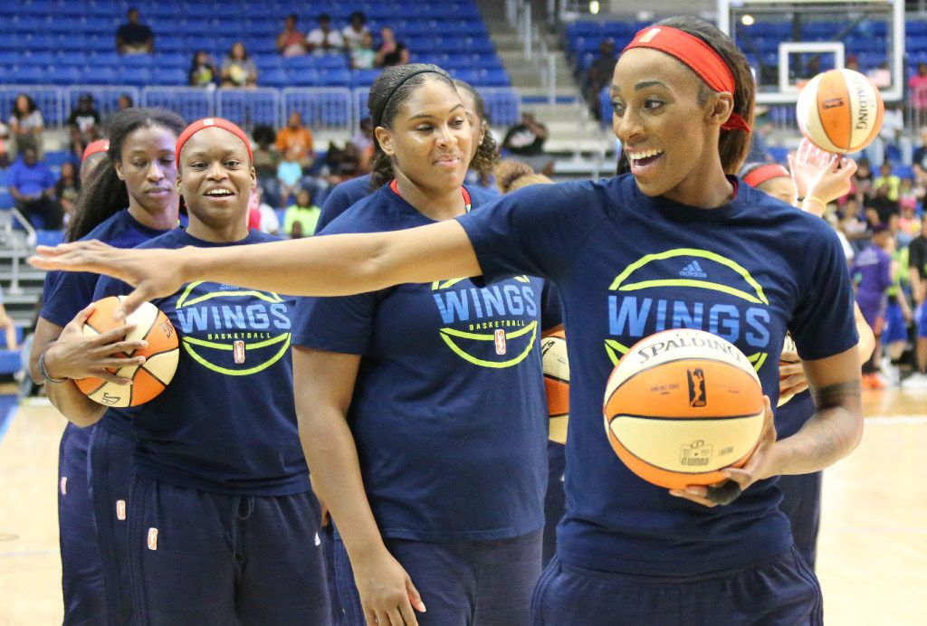 Dallas Wings forward Glory Johnson (25) waves to a fan before the Dallas Wings vs. Phoenix Mercury WNBA basketball game at the UTA College Park Center in Arlington, Texas on Thursday, August 10, 2017. (Louis DeLuca/The Dallas Morning News)