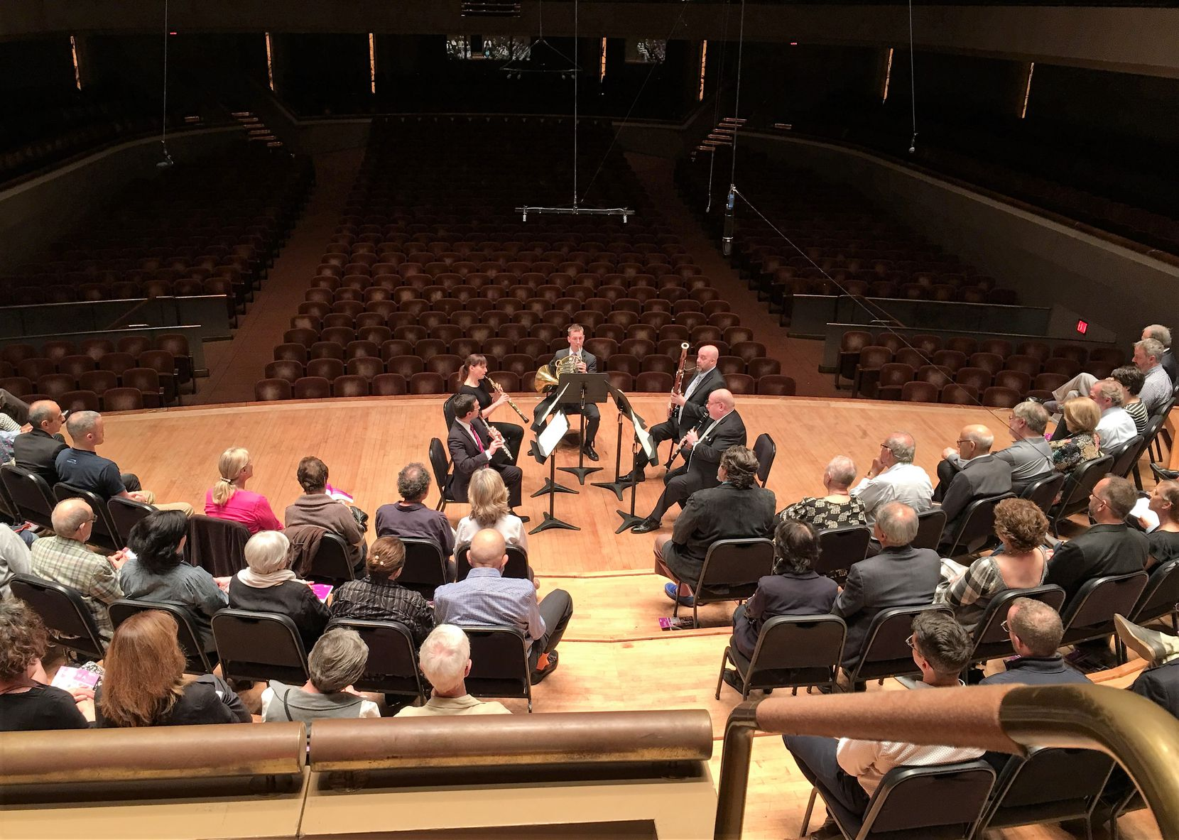 View from the Meyerson Symphony Center's choral terrace, as Dallas Symphony Orchestra musicians David Buck (flute), Erin Hannigan (oboe), David Cooper (horn), Ted Soluri (bassoon) and Gregory Raden (clarinet) perform a wind quintet arrangement of Mozart's Magic Flute Overture on April 8, 2019. (Scott Cantrell/Special Contributor)