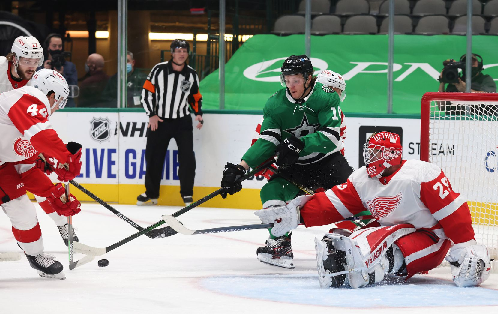 Dallas Stars Ty Dellandrea (10) looks to shoot as Detroit Red Wings defenseman Christian Djoos (44) and Detroit Red Wings goaltender Thomas Greiss (29) defend the goal during the first period of play at American Airlines Center on Tuesday, January 26, 2021in Dallas. (Vernon Bryant/The Dallas Morning News)