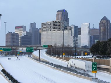 Snow covers US 75 heading into Downtown in Dallas on Monday morning, Feb. 15, 2021.