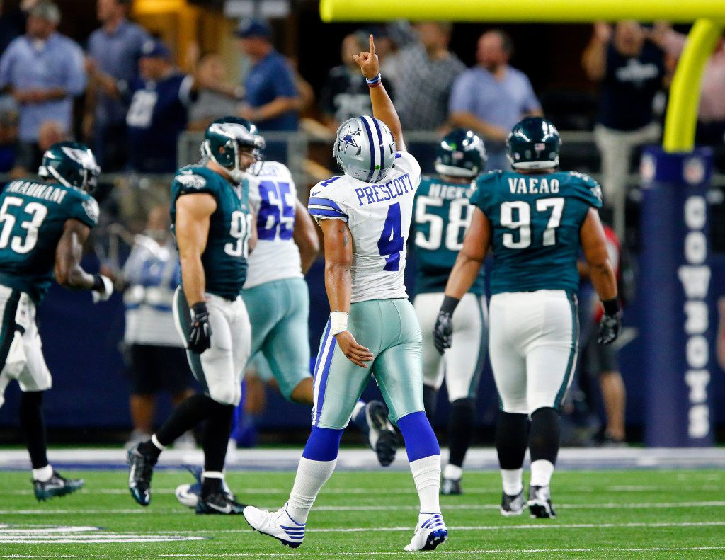 Dallas Cowboys quarterback Dak Prescott (4) points skyward after he threw Dez Bryant a touchdown catch in the fourth quarter against the Philadelphia Eagles at AT&T Stadium in Arlington, Texas, Sunday, October 30, 2016. The Cowboys won, 29-23. (Tom Fox/The Dallas Morning News)