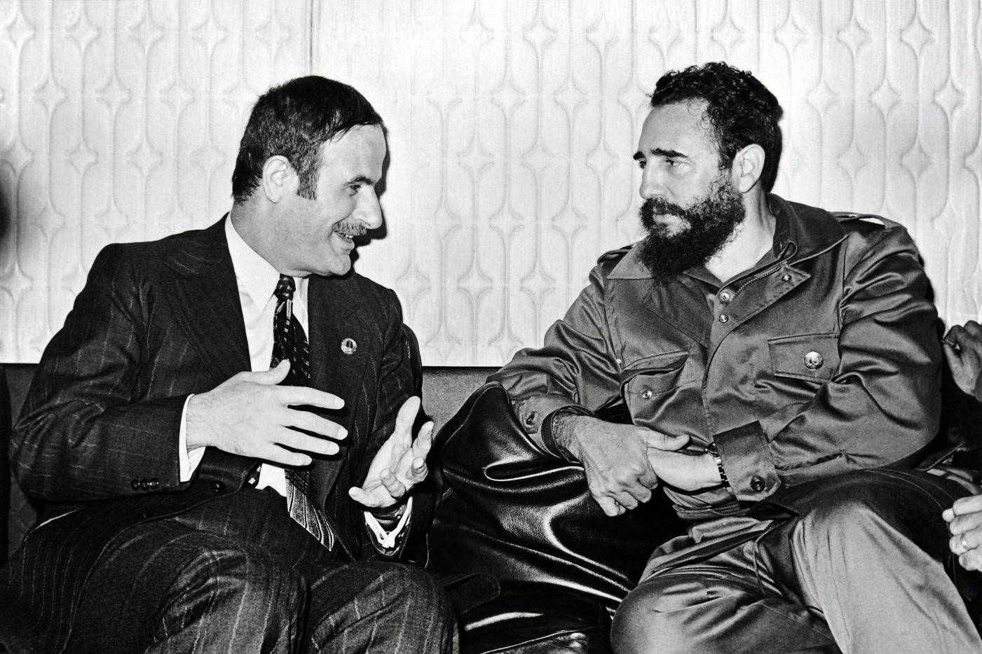 Syrian President Hafez al-Assad (L) speaking with then Cuban leader Fidel Castro during a meeting in Damascus September 9, 1973.