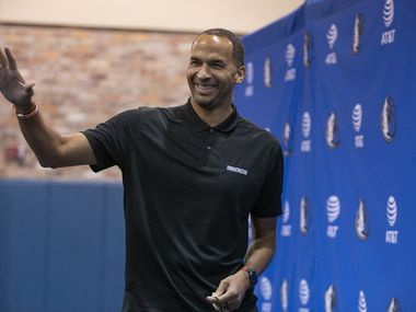 Dallas Mavericks General Manager Nico Harrison waves as he leaves a press conference in Dallas, Friday, August 27, 2021.