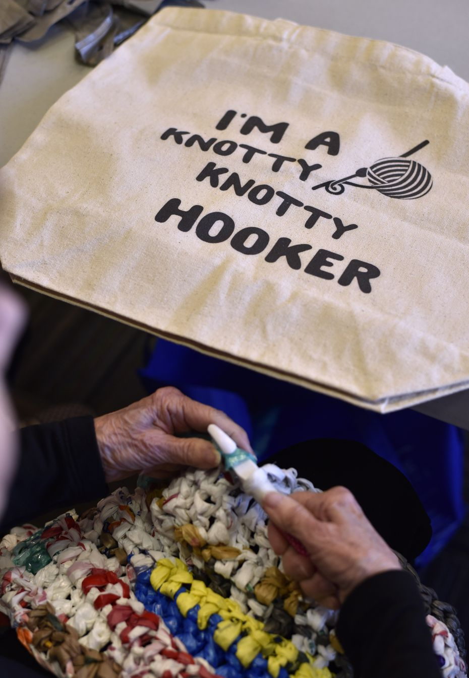 Joan Jackson brings her custom bag to the center for her volunteer work with the Happy Hookers.