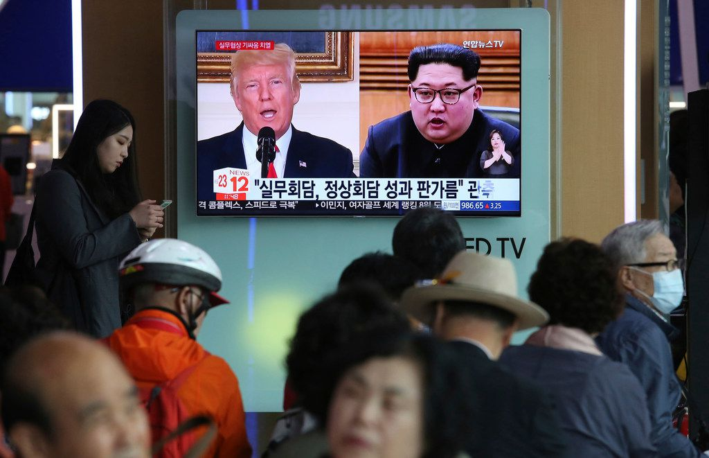"People watch a TV screen showing images of U.S. President Donald Trump (left) and North Korean leader Kim Jong Un during a news program at the Seoul Railway Station in Seoul. A team of American diplomats involved in preparatory discussions with North Korea ahead of a potential summit between Trump and Kim left a hotel in Seoul on Tuesday amid speculation that they are resuming the talks. The signs read: ""Working-level talks."""