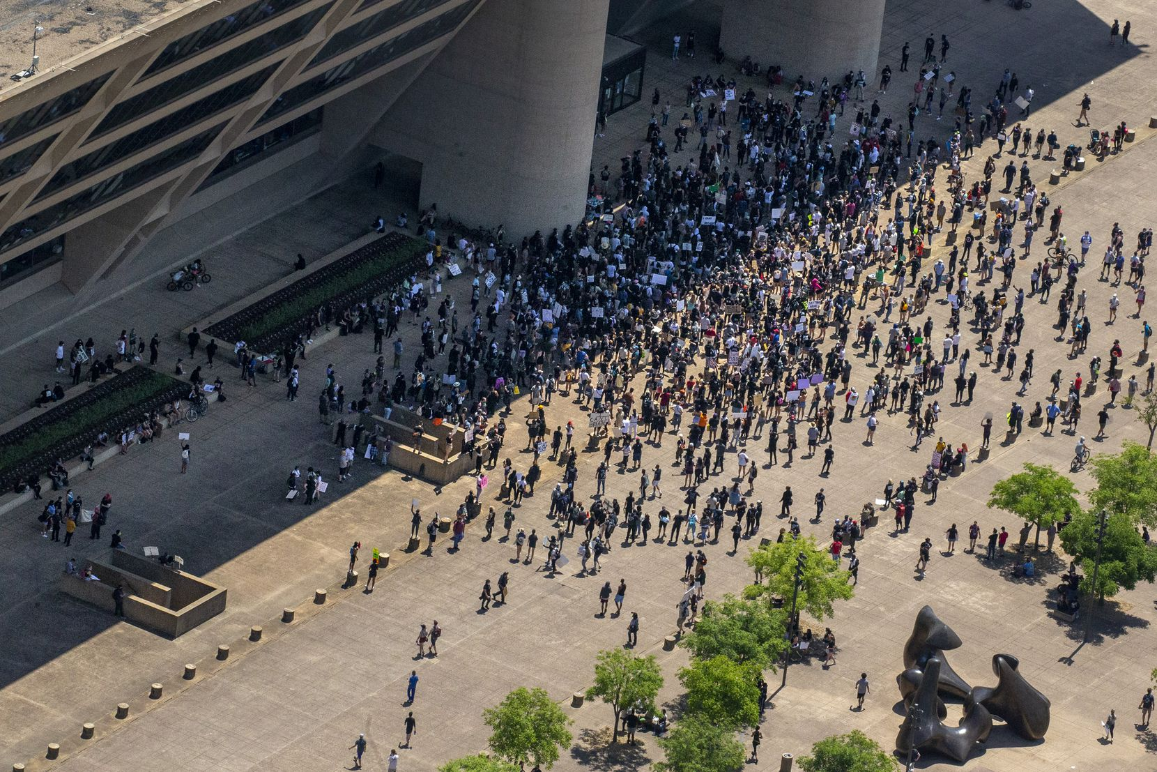 After marching throughout downtown Dallas, protesters march back to Dallas City Hall during a demonstration denouncing police brutality in Dallas on Saturday, May 30.