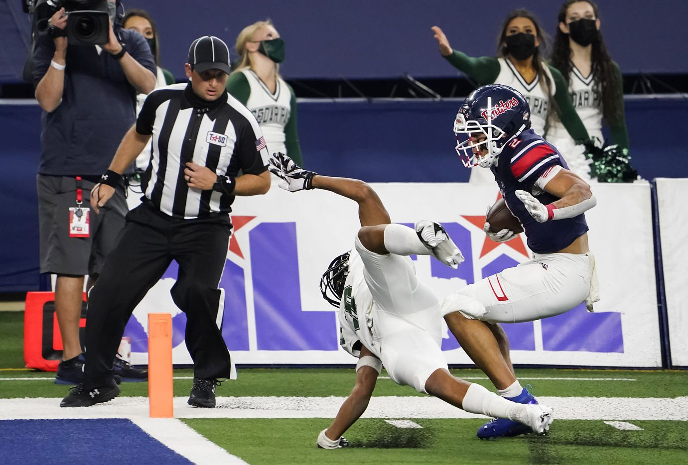 Denton Ryan Billy Bowman Jr. (2) slips past Cedar Park defensive back Michael Putney (6) to score on a hauls in a 37-yard touchdown pass from quarterback Seth Henigan during the first half of the Class 5A Division I state football championship game at AT&T Stadium on Friday, Jan. 15, 2021, in Arlington, Texas. (Smiley N. Pool/The Dallas Morning News)
