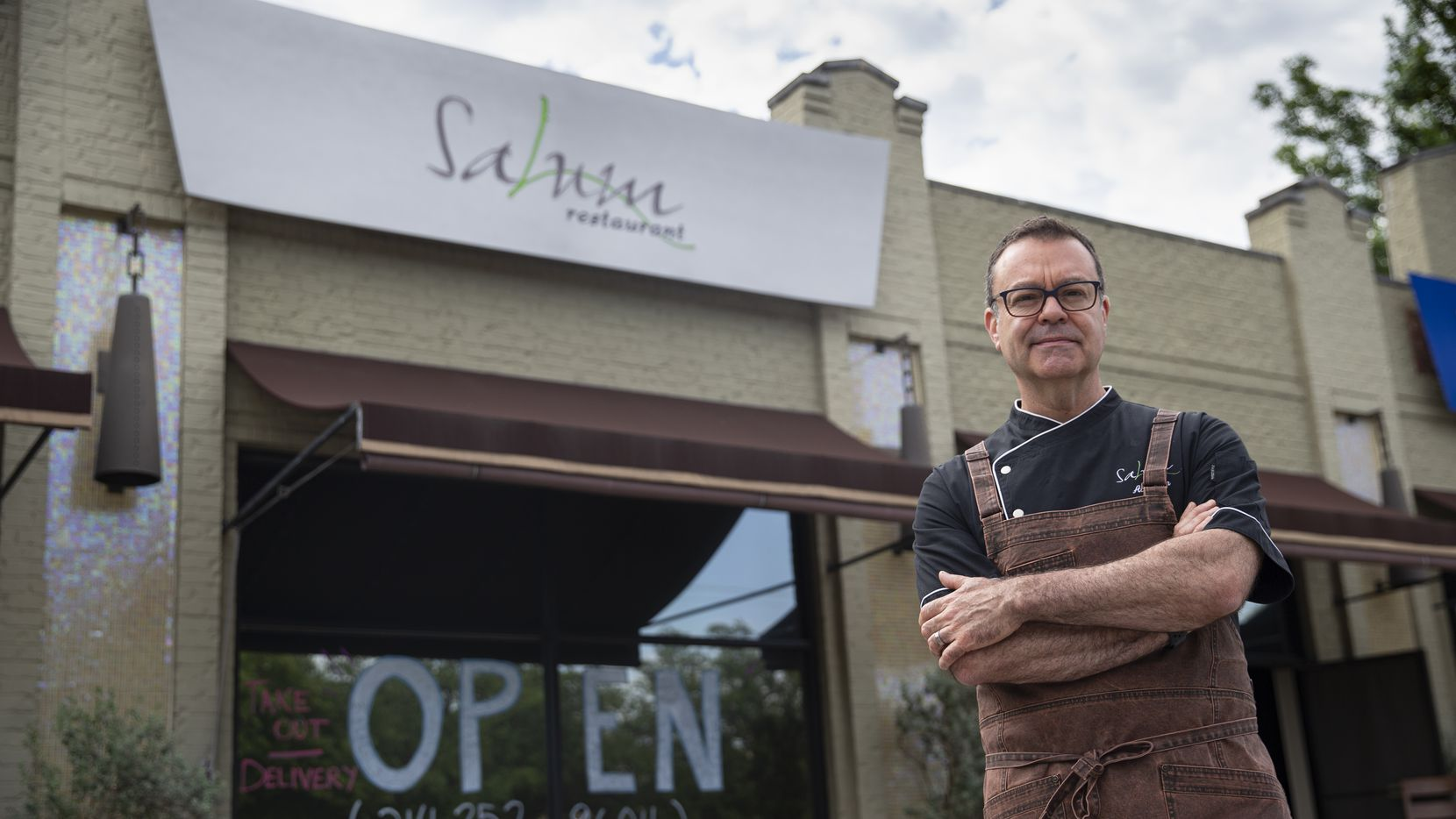 Chef Abraham Salum stands outside of Salum restaurant on Cole Avenue on May 7, 2020 in Dallas. Salum was shocked and surprised to learn that his insurance company would not pay his business interruption claim.