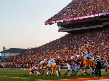 The Texas Longhorns punt for the extra point after scoring a touchdown in the second quarter of a college football game between the University of Texas and Louisiana State University on Saturday, Sept. 7, 2019 at Darrell Royal Memorial Stadium in Austin, Texas.