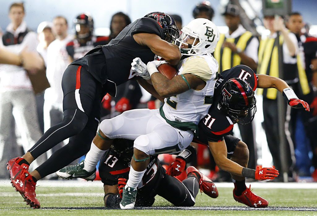 Baylor Bears running back Shock Linwood (32) carries the ball against the Texas Tech Red Raiders defense in the second quarter at AT&T Stadium in Arlington, Texas, Saturday, November 29, 2014. (Tom Fox/The Dallas Morning News)