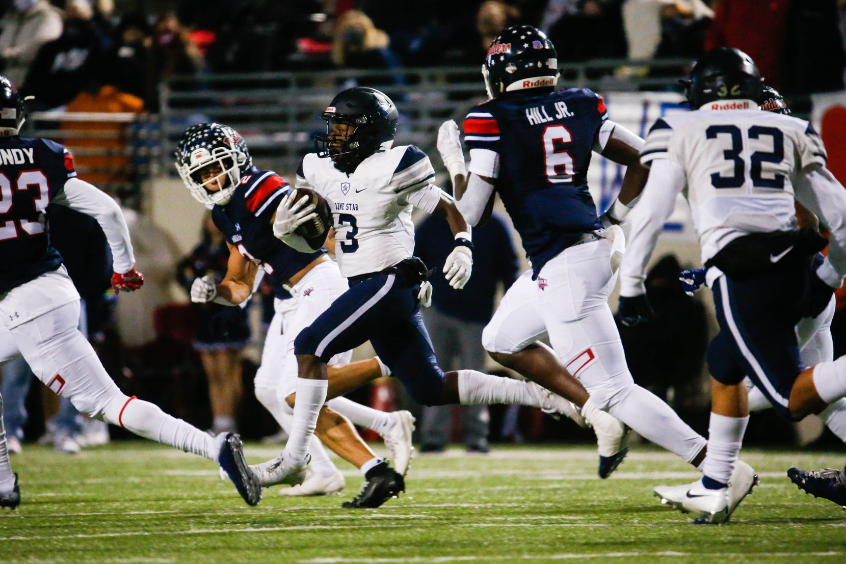 Frisco Lone Star's Tolu Sokoya (3) runs the ball during the first half of a football game against Denton Ryan at the C.H. Collins Complex in Denton on Thursday, Dec. 4, 2020. The game is tied at halftime, 14-14. (Juan Figueroa/ The Dallas Morning News)