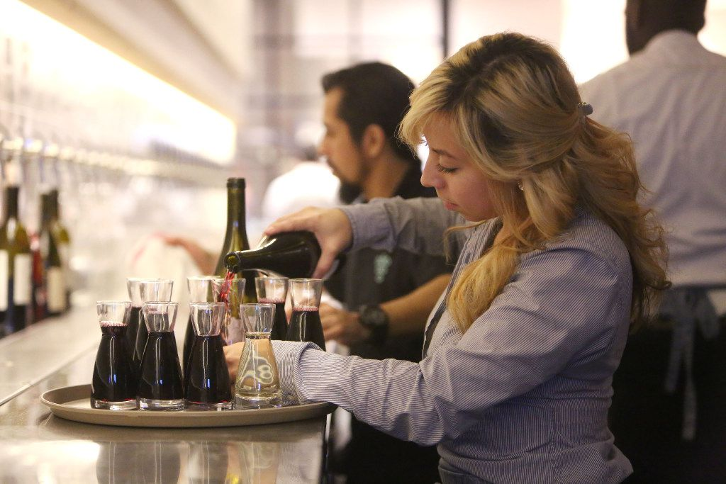 Bartender Christina Valencia pours wine at Sixty Vines, a new wine-centric restaurant in Plano from the owners of Whiskey Cake.
