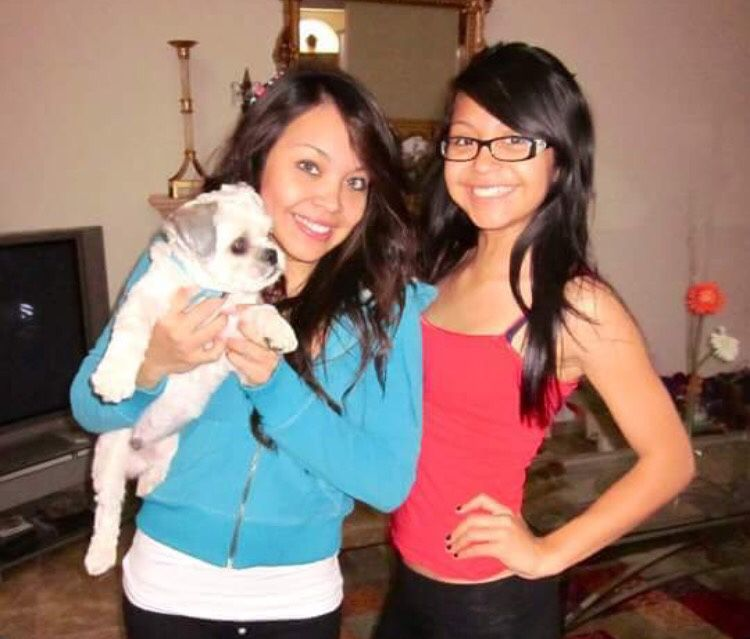 Jessica Urbina, left, holds Bam Bam back when he was still a puppy. Urbina was reunited with the dog Monday night, four years after she says he was stolen from her yard in Mesquite.
