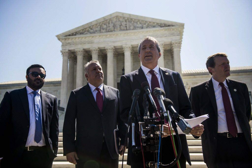 WASHINGTON, DC - JUNE 9:  Texas Attorney General Ken Paxton speaks to reporters at a news conference outside the Supreme Court on Capitol Hill on June 9, 2016 in Washington, D.C. Paxton announced a lawsuit against the state of Delaware over unclaimed checks.  (Photo by Gabriella Demczuk/Getty Images)