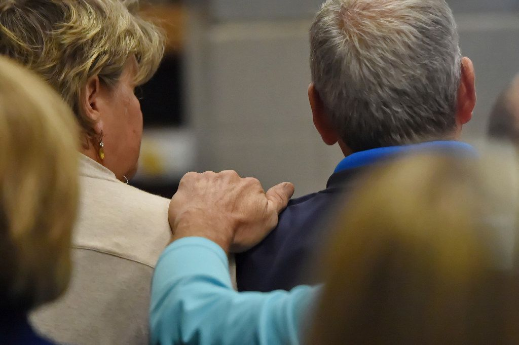 Family members of victims in the bike shop murders comfort each other in the courtroom of Judge Jimmy Henson during a bond hearing for Todd Kohlhepp at the Spartanburg Detention Facility, in Spartanburg, S.C. Sunday, Nov. 6, 2016. Kohlhepp was charged with four counts of murder in what is known as the bike shop murders in 2003 in Chesnee, S.C. His alleged role in those killings was uncovered, authorities said, after a woman was found last week in a locked metal container on Kohlhepp's property in rural Woodruff. (AP Photo/Richard Shiro)