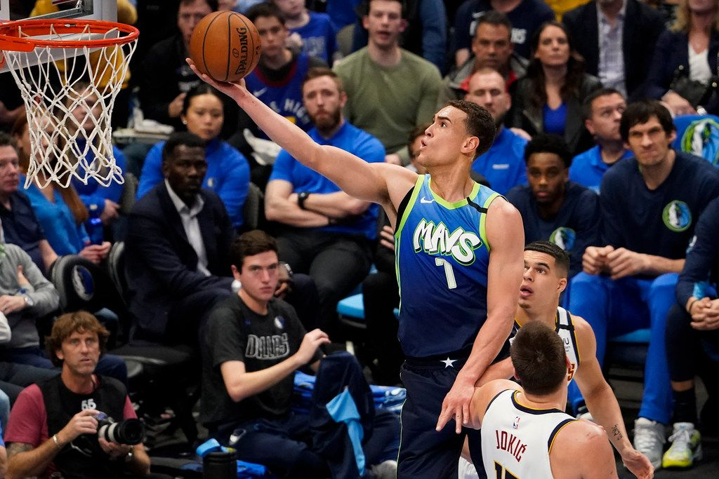 Dallas Mavericks forward Dwight Powell (7) shoots over Denver Nuggets center Nikola Jokic (15) during the first half of an NBA basketball game at American Airlines Center on Wednesday, Jan. 8, 2020, in Dallas. (Smiley N. Pool/The Dallas Morning News)