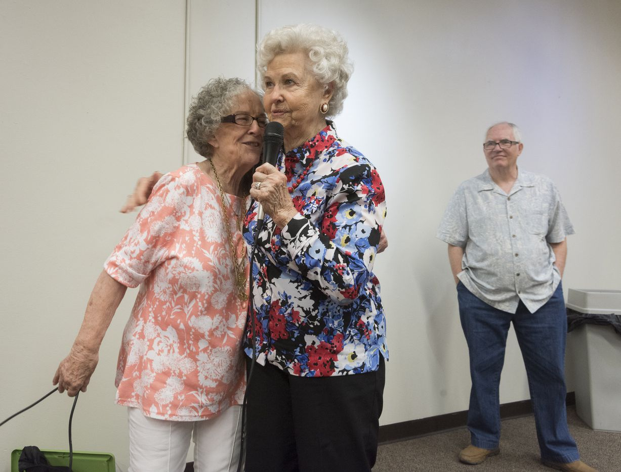 Ginnie Siena Bivona, left, hugs Barbara Mott, 92, as Mott talks about how she became an author at 82 with the urging of Bivona during a book signing event at Half Price Books on Sunday, June 26, 2016.  Bivona and Larry Upshaw, right, have have launched Ageless Authors, a publishing project for people 65 and older.   (Rex C. Curry/Special Contributor)