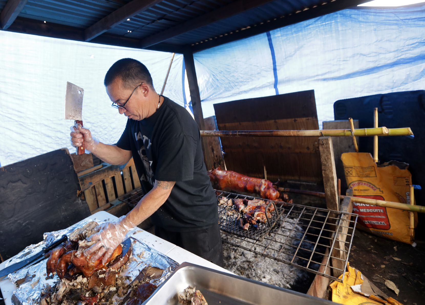 Allen Cook prepares some food at Old Rooster Creek Filipino Asian/American BBQ in Princeton.