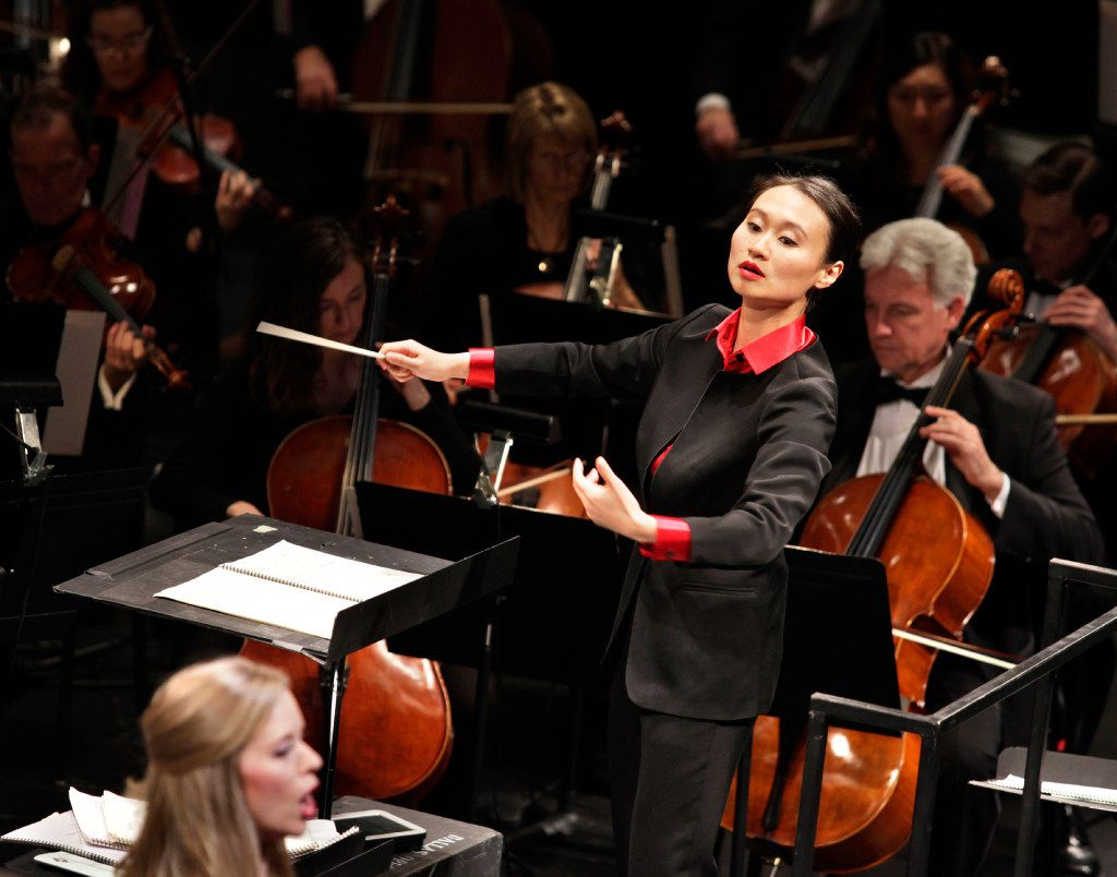 Tianyi Lu conducts during the Institute For Women Conductors event at the Winspear Opera House in Dallas, TX, on Dec. 10, 2016. (Jason Janik/Special Contributor)