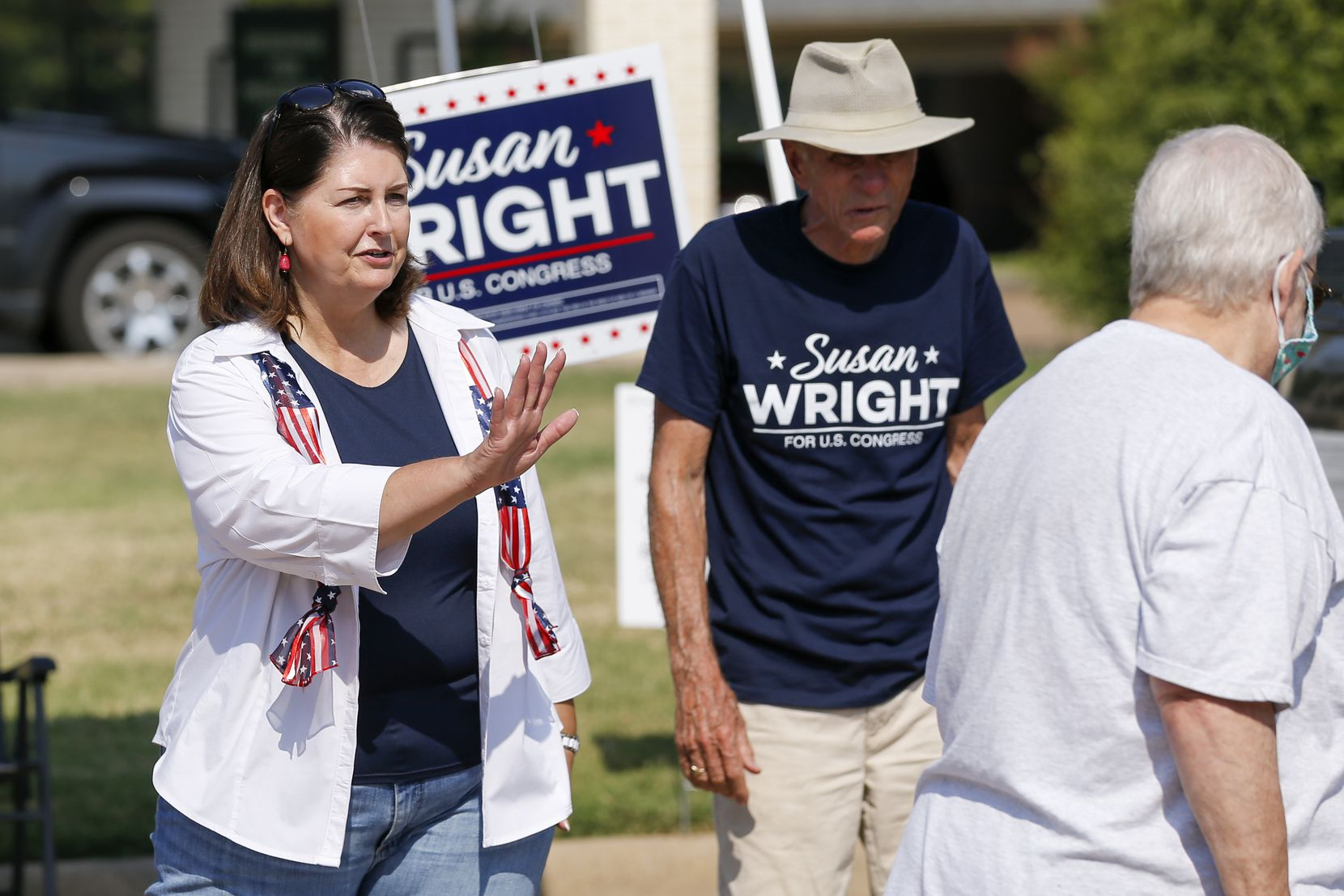 Susan Wright, Republican candidate for Texas' 6th Congressional District, greets voters outside a polling location during early voting for a special runoff election on Thursday, July 22, 2021, in Arlington. (Elias Valverde II/The Dallas Morning News)