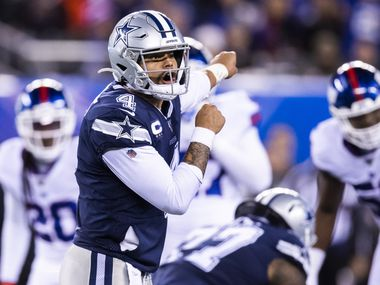 FILE - Cowboys quarterback Dak Prescott (4) shouts a call during the fourth quarter of a game against the New York Giants on Monday, Nov. 4, 2019, at MetLife Stadium in East Rutherford, N.J.