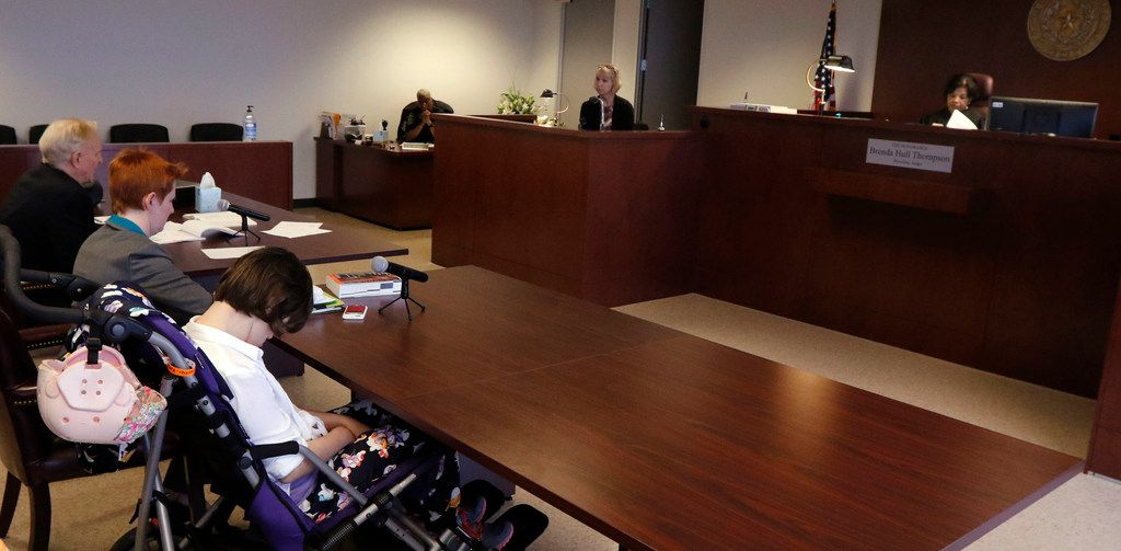 Christy Zartler, on the witness stand, answers questions from her attorney, Rick O'Connor (left) and her daughter Kara's attorney, Ellen Williamson (second from left), next to Kara, in Judge Brenda Hull Thompson's courtroom.