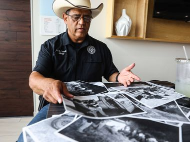 Culberson County Sheriff Oscar Carrillo shows photos of the work his office in Van Horn does answering calls involving unauthorized immigrants crossing the border from Mexico into the United States through his county.