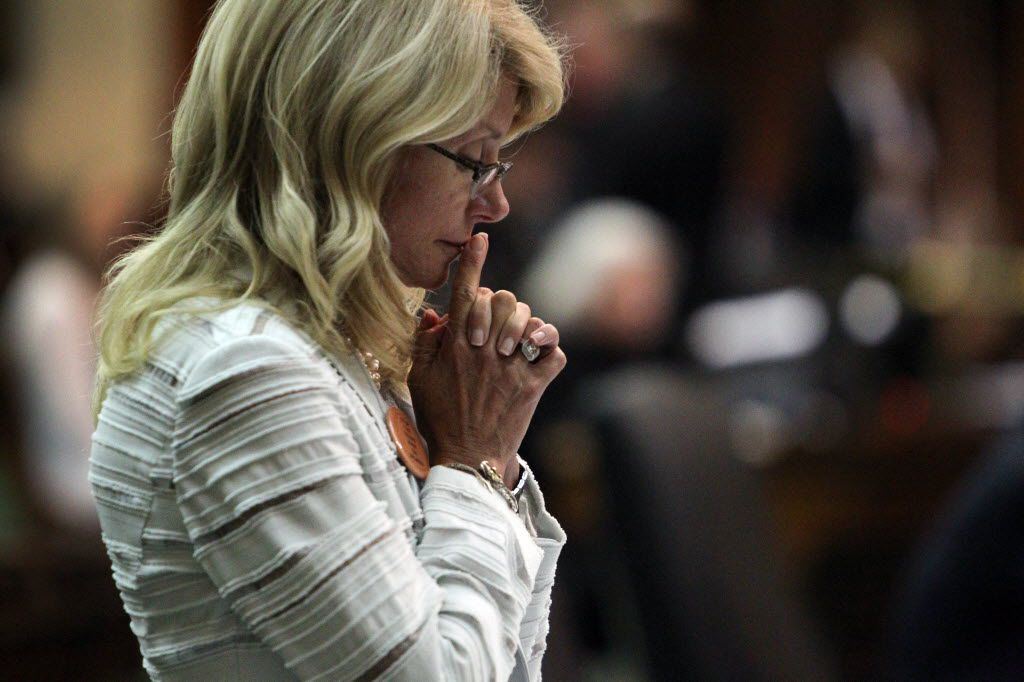 State Sen. Wendy Davis spent a quiet moment after her filibuster was halted June 25, 2013 — the final day of the legislative special session — as the Senate considered an abortion bill.