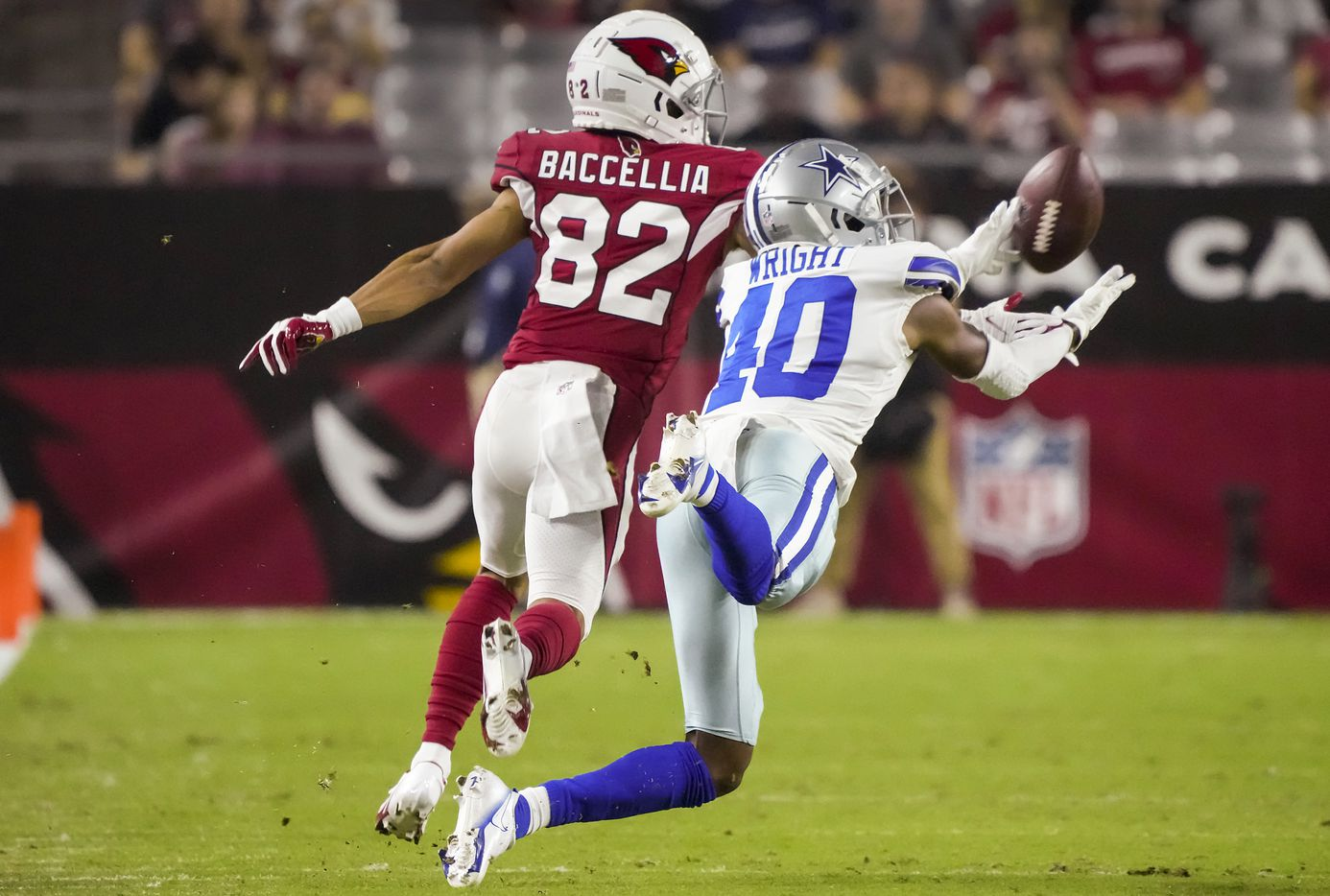 Dallas Cowboys cornerback Nahshon Wright (40) breaks up a pass intended for Arizona Cardinals wide receiver Andre Baccellia (82) during the second half of a preseason NFL football game at State Farm Stadium on Friday, Aug. 13, 2021, in Glendale, Ariz.