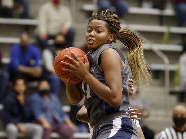 Wylie East's Akasha Davis (41) grabs a rebound against Red Oak during the Class 5A Region II girls basketball semifinal on Feb. 26, 2021 in Flower Mound, Tx.