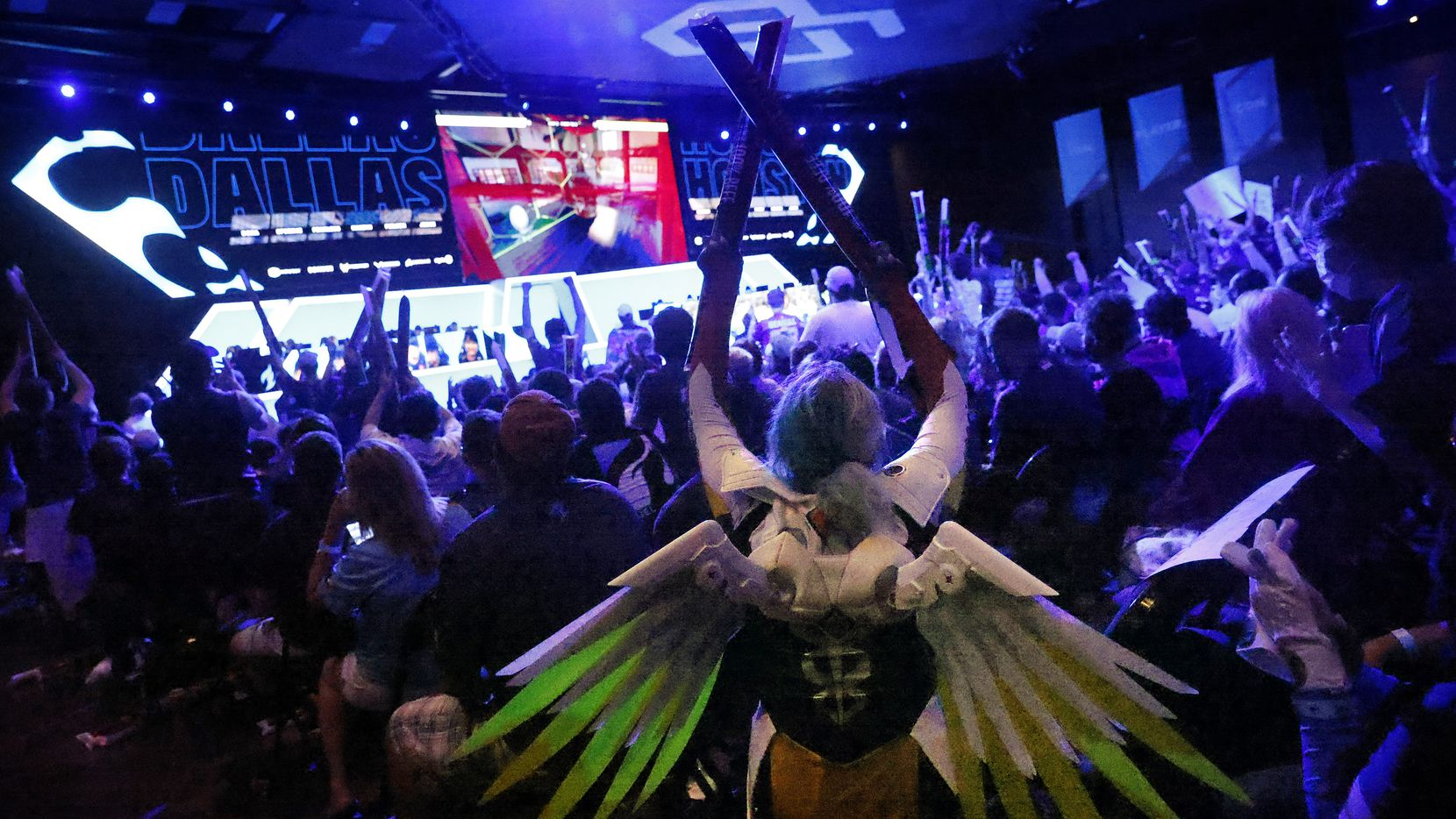 Dallas Fuel fan Hope Hopkins of Alvarado, Texas came dressed as Mercy, a character from Overwatch League. She another fans cheered as the Fuel won a map during their match against the Houston Outlaws at Esports Stadium Arlington Friday, July 9, 2021.