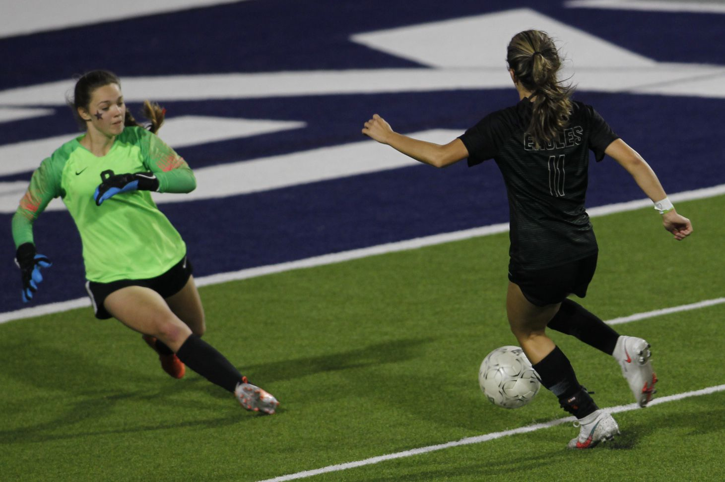 Coppell goalkeeper Zoe Goodale (0), left, aggressively leaves the net to charge Prosper's Emma Yolinsky (11) and save a goal during first half action. Prosper prevailed 2-0 to advance. The two teams played their Class 6A bi-district girls soccer playoff game at McKinney ISD Stadium in McKinney on March 26, 2021. (Steve Hamm/ Special Contributor)