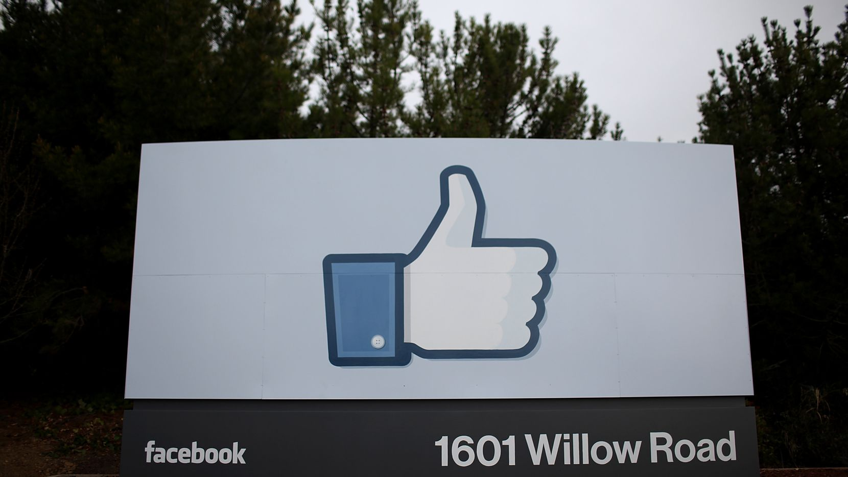 "A sign with the ""like"" symbol stands in front of the Facebook headquarters in Menlo Park, Calif."