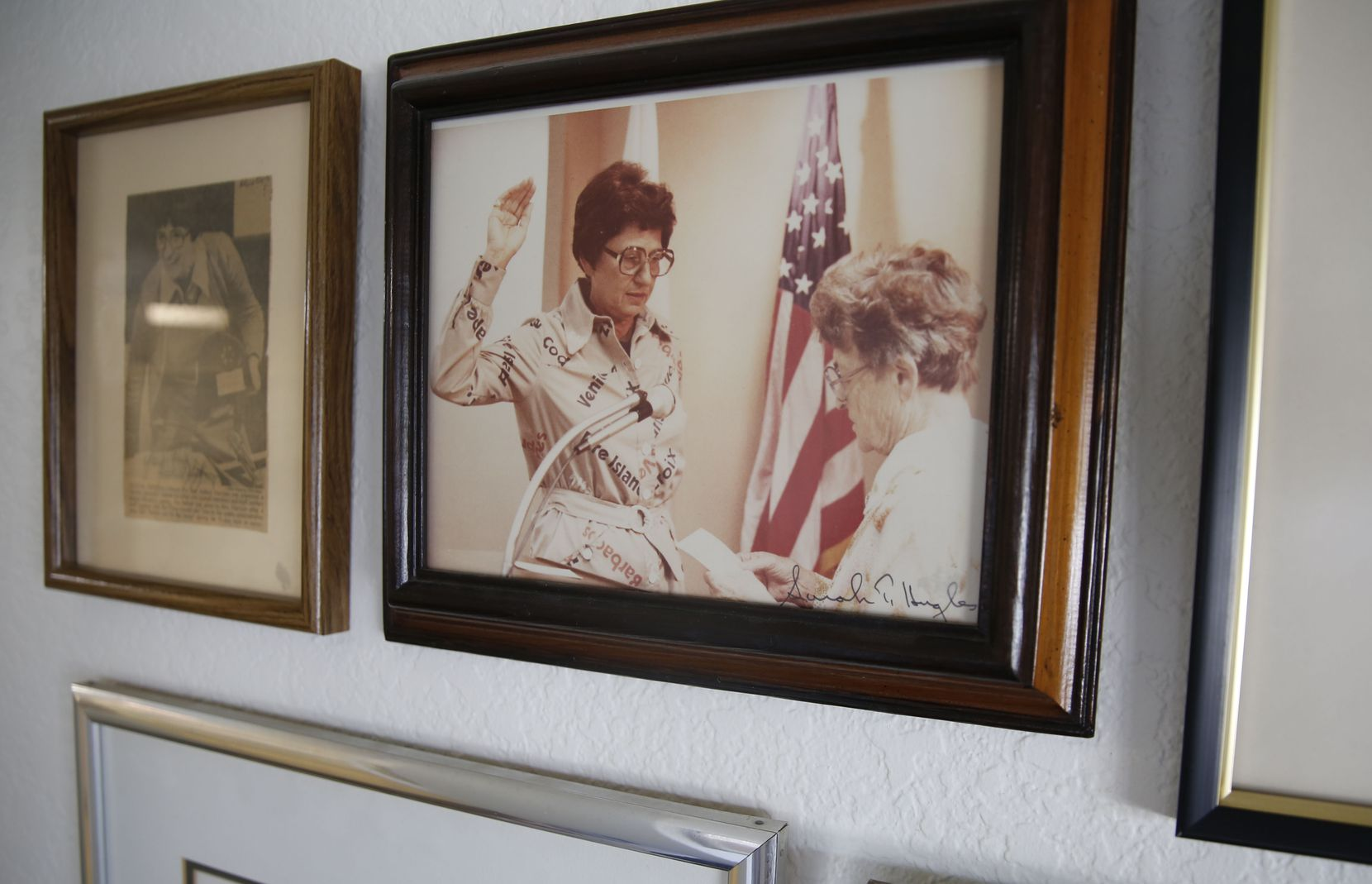 Adlene Harrison (left), Dallas' first female mayor, is sworn in as EPA regional administrator by U.S. District Judge Sarah T. Hughes in a photo that hangs on the wall of Harrison's home in Dallas.