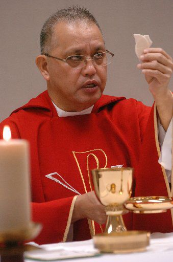 Edmundo Paredes celebrated Mass on June 5, 2008, in a trailer after the fire that destroyed St. Cecilia Catholic Church a year earlier.