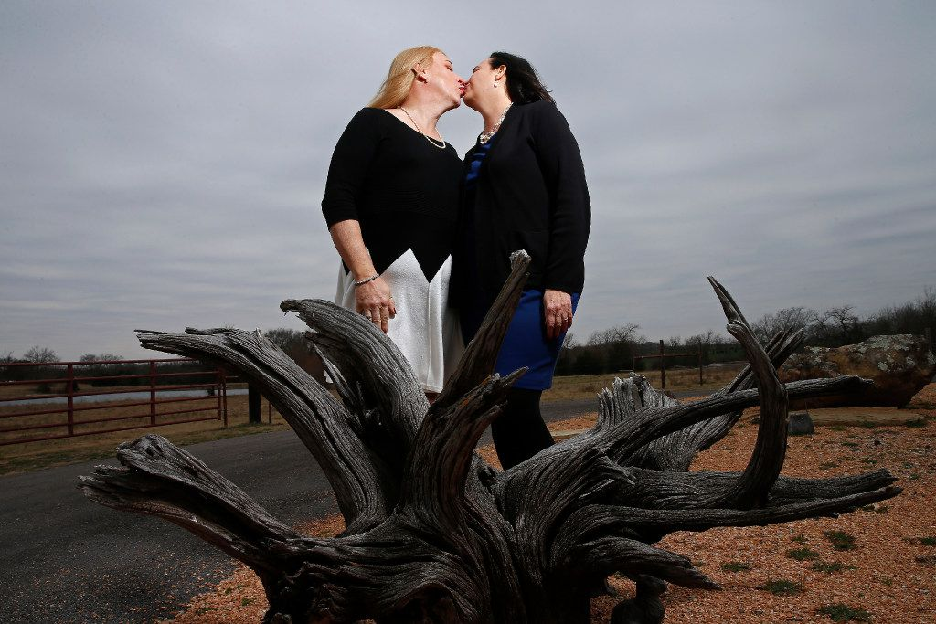 Mayor Jess Herbst (left) kisses her wife Debbie at their home in New Hope.