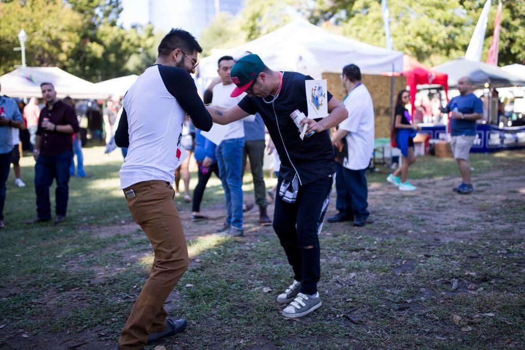 Jesus Cervantes (left) and Emilio Vargas danced at Texas Latino Gay Pride 2016 at Reverchon Park in Oak Lawn.
