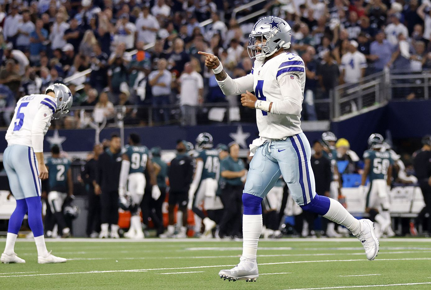 Dallas Cowboys quarterback Dak Prescott (4) runs to the sideline after they scored a first quarter touchdown against the Philadelphia Eagles at AT&T Stadium in Arlington, Monday, September 27, 2021. (Tom Fox/The Dallas Morning News)