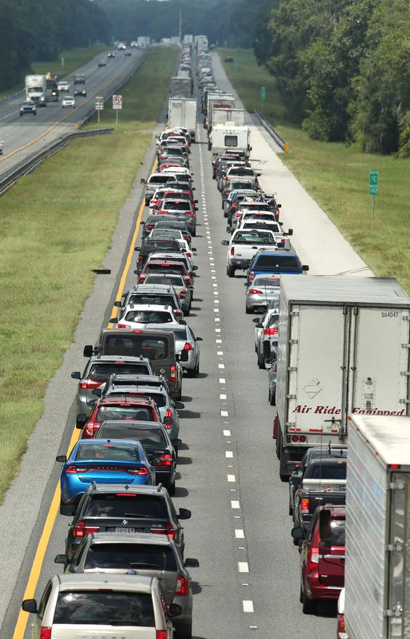 Traffic crawls on the northbound lanes of Florida's Turnpike near the intersection of Interstate 75 in Wildwood on Friday. Motorists are evacuating for the anticipated arrival of Hurricane Irma.